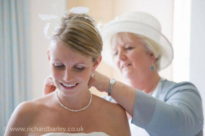 bride and mother preparing